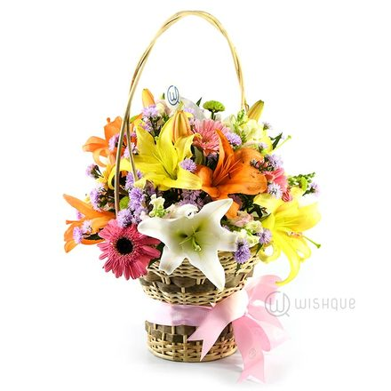 Flowers in a Rainbow Lily Bucket