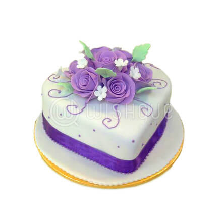 Heart Shape Cake With Purple Flowers Topper